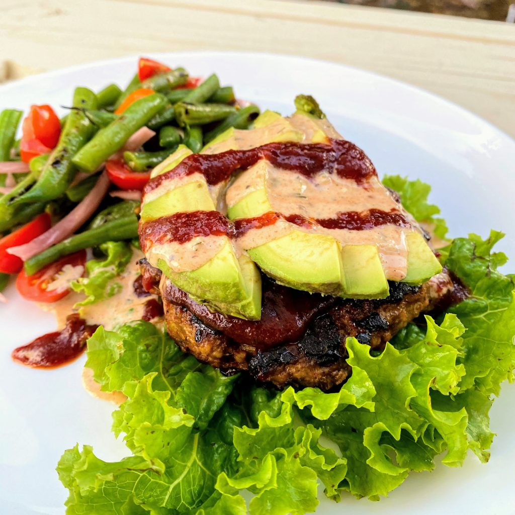 Closeup of BBQ Bacon Turkey Burgers with Avocado and Sauces
