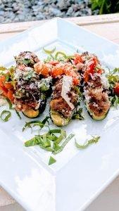 Closeup of plated sausage stuffed zucchini