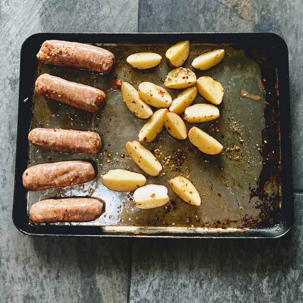 First STep of Sausage Broccoli and Potato Sheet Pan Dinner