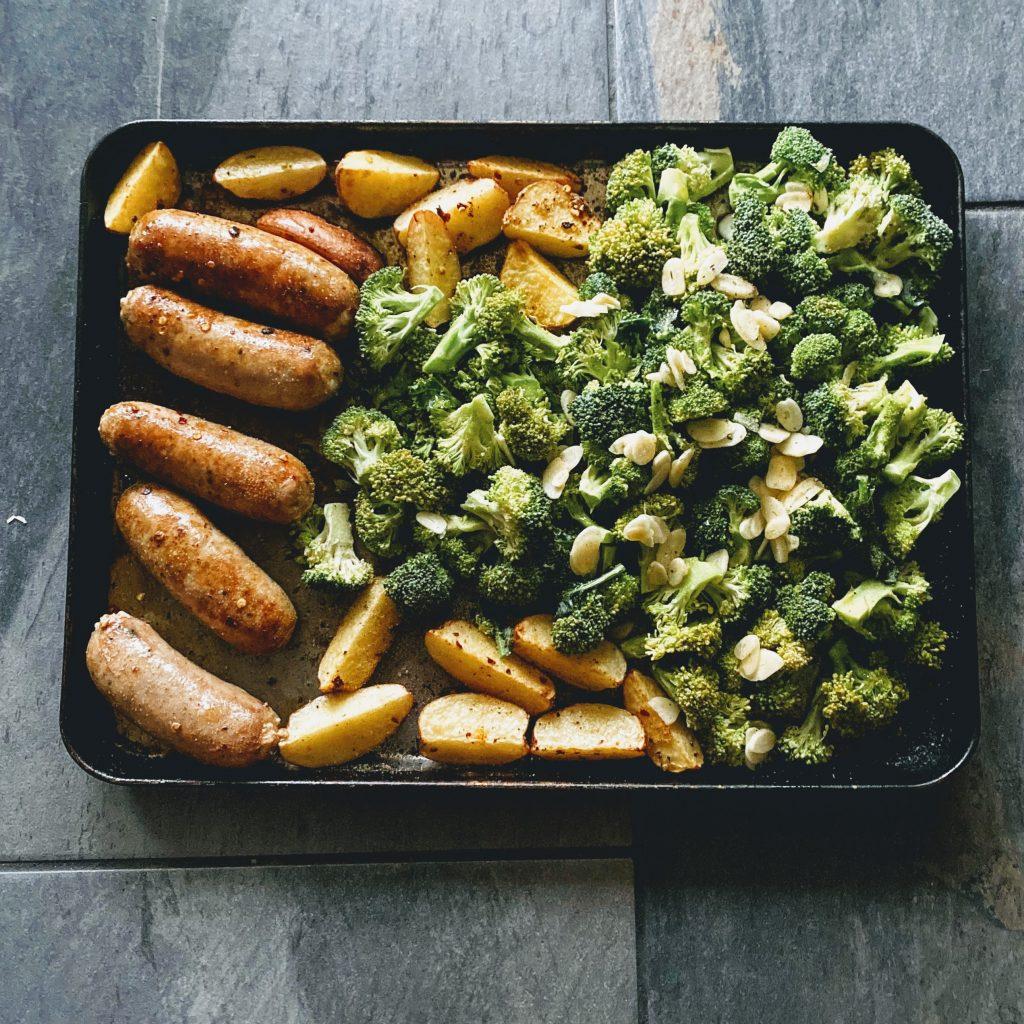 Second Step of Sausage Broccoli and Potato Sheet Pan Dinner